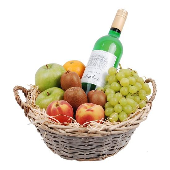Fruitmand met witte wijn